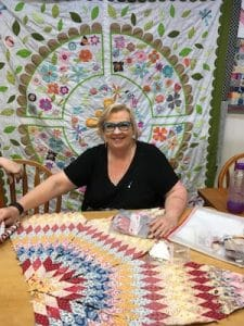 Jennifer Corkish Quilt Teacher in Class at Berry Quilt & Co. with two of her 2018 Projects