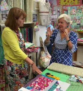 Sheena Chapman helping Dianne with her quilt.