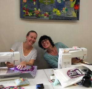 Skye and Charlotte happily sewing