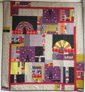 Sheena Chapman's 'State Fair' quilt built around the great piece of vintage purple carnival fabric!