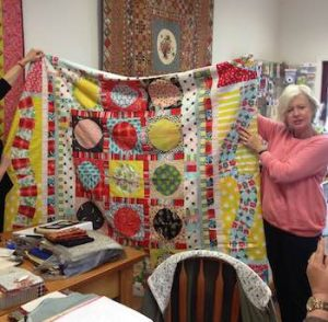 Sheena Chapman in class showing off her Jungle Fever quilt